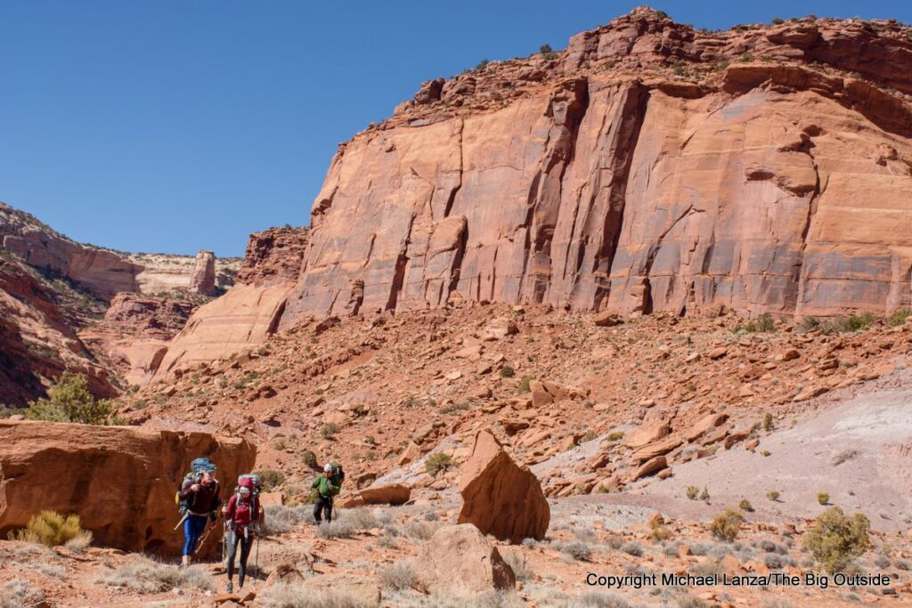Backpackers on the North Canyon Trail in the Maze District, Canyonlands National Park.