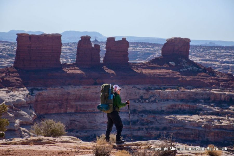 A backpacker at the Maze Overlook in the Maze District, Canyonlands National Park.