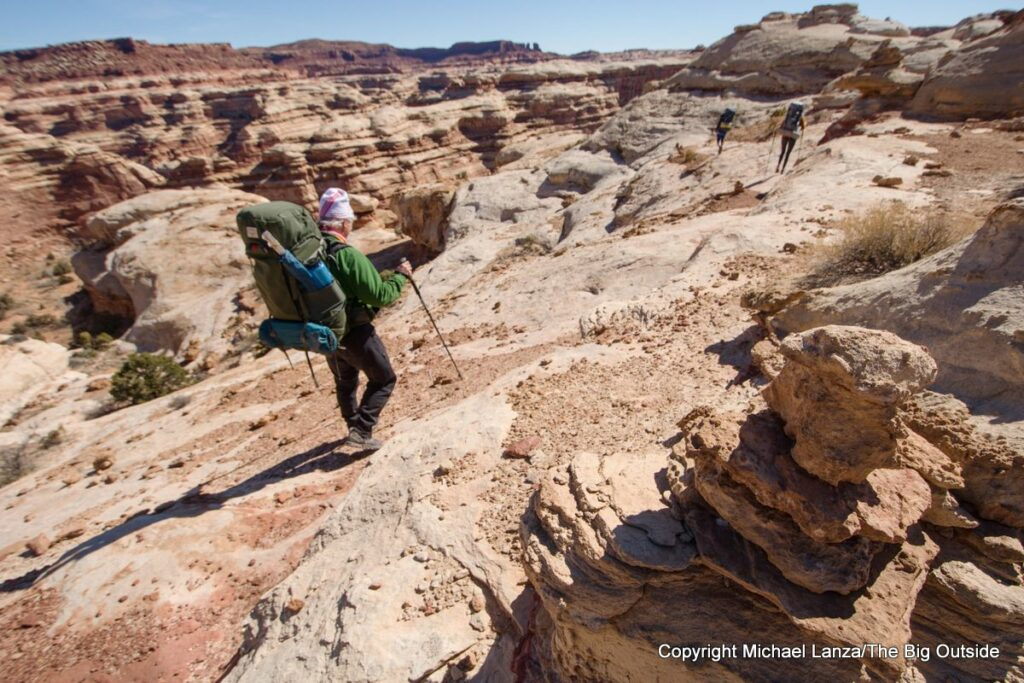 Backpackers on the trail off Maze Overlook in the Maze District, Canyonlands National Park.