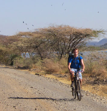 Joel biking in Bogoria