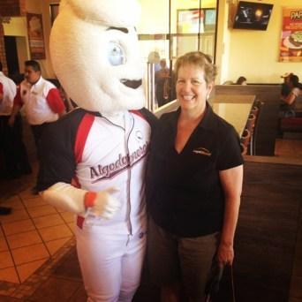 Mama D with Mascot Homero