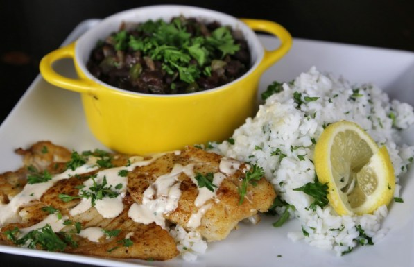 Blackened Tilapia with lemony crema sauce with black beans and cilantro rice