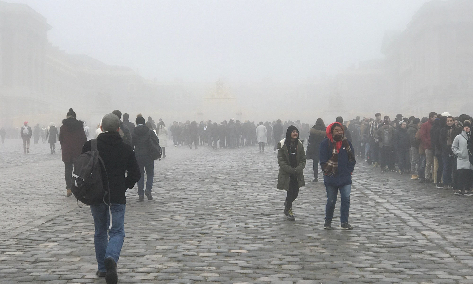 photo of crowds in the fog outside Versailles