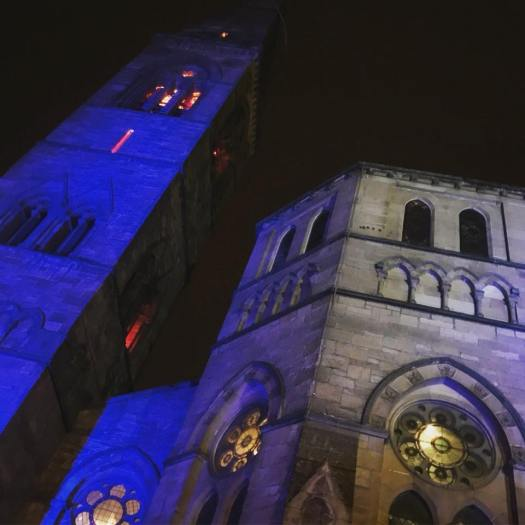 Photo of a church lit up in blue light