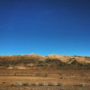 Photo of a desert landscape with mountains