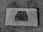 "Strange grave marker behind baseball field. ""Pepi: A friend to everyone"""