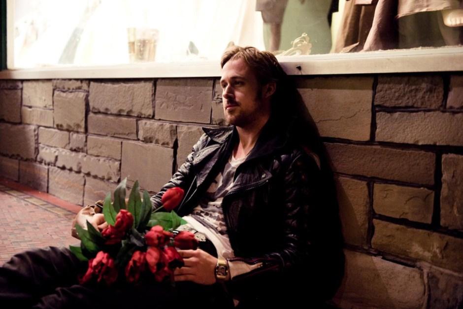 Ryan Gosling holding sad roses in Blue Valentine.