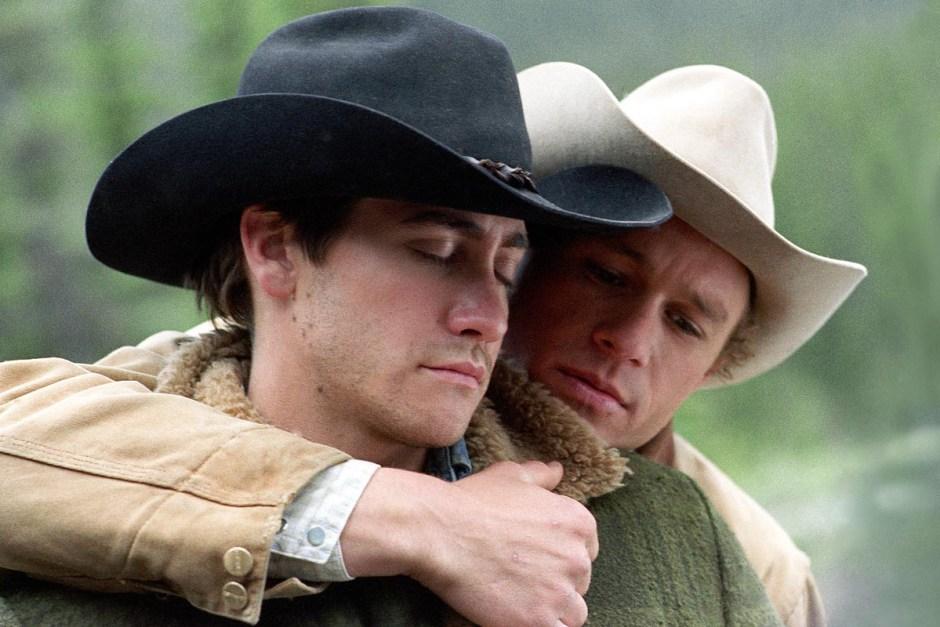 Heath Ledger embraces Jake Gyllenhaal in Brokeback Mountain.