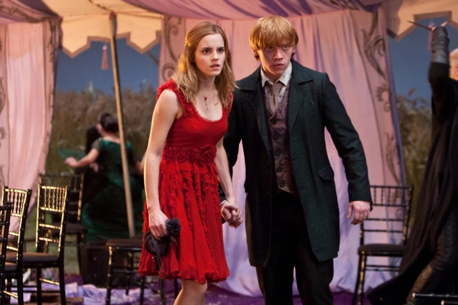 Ron and Hermione hold hands after wedding attack in Harry Potter and the Deathly Hallows Part I.