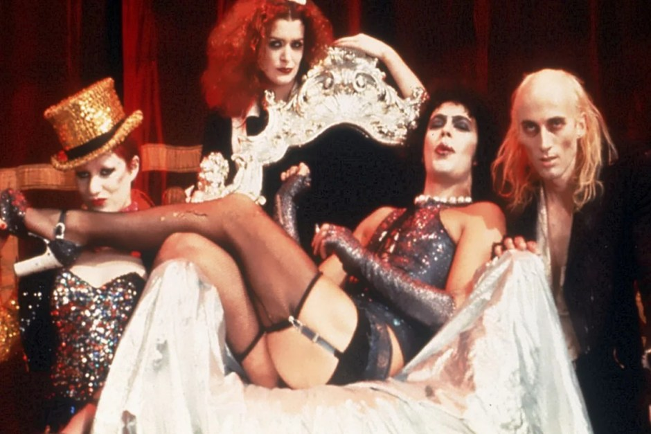Tim Curry sits on the throne in The Rocky Horror Picture Show.