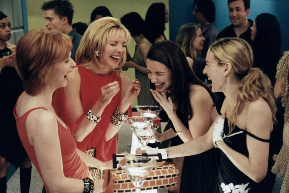 The four women laugh over cocktails in Sex and the City.