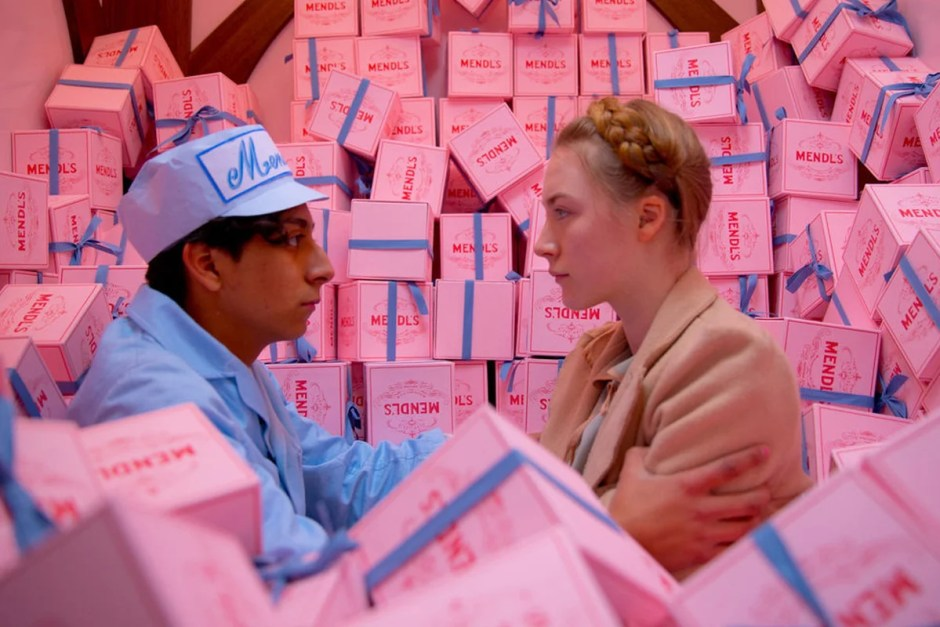 Mendl's cake boxes surround young love in The Grand Budapest Hotel.