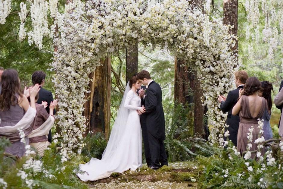 Twilight: Breaking Dawn wedding under trellis.