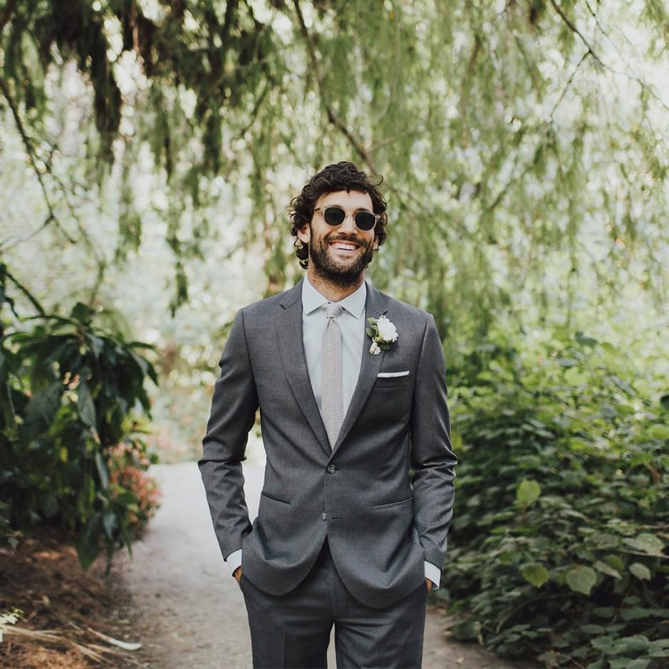 Man in grey men's suit with necktie.