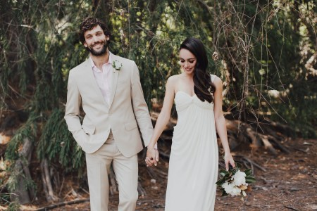 Man in grey groom suit with woman in bridal dress.