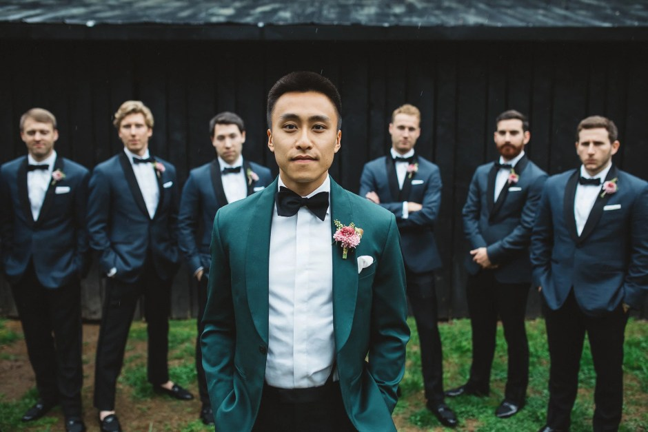 Groomspeople in tuxedos and evidence of a successful groomsmen proposal