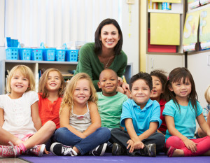 Group of Elementary Pupils In Classroom With Teacher