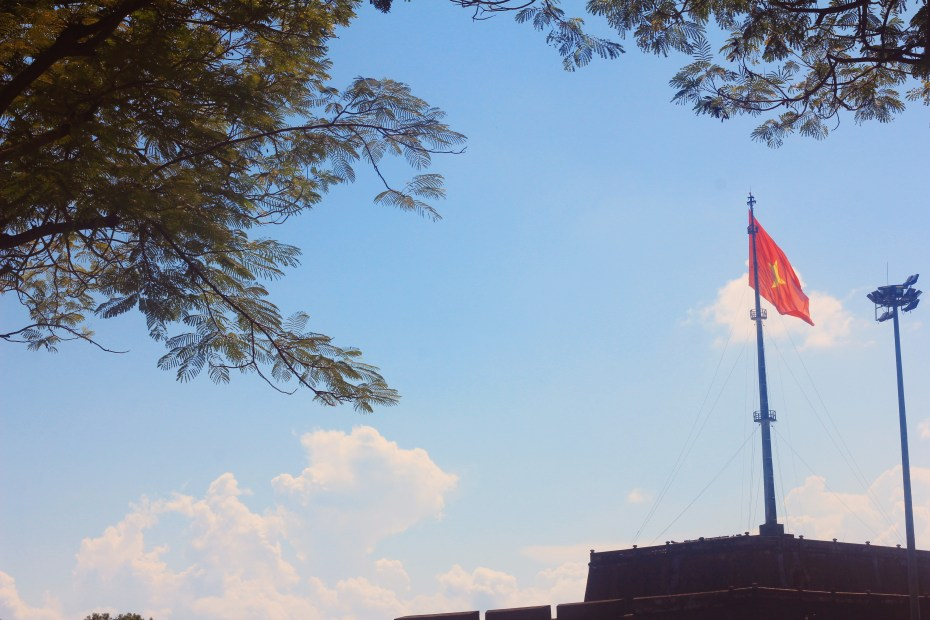 A flag waving outside of the Impirial City of Hue, Vietnam