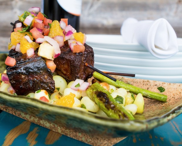 Miami Restaurant, Pisco y Nazca serves the most delicious braised beef ribs with a mango salsa. They are called anticucho de costilla. Click to read about their other dishes on the menu or pin to save for later!