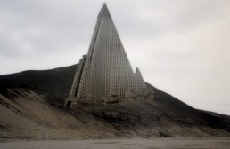 The 105-story, pyramid-shaped hotel that has stood over North Korea's capital city like a mountain for more than 20 years. Completed, it would be the 3rd tallest building in the world. The structure, (designed by Baikdoosan Architects & Engineers) first began construction back in 1987. With a completion date of 1989, it was intended to be open in time for the 13th World Festival of Youth and Students. If this had taken place, the Ryugyong would have been the tallest hotel in the world at that time. For several decades the unfinished hotel towered above the city of Pyongyang, an idle hulk serving as a mocking reminder of North Korea's broken economy and government system. Courtesy Sobify