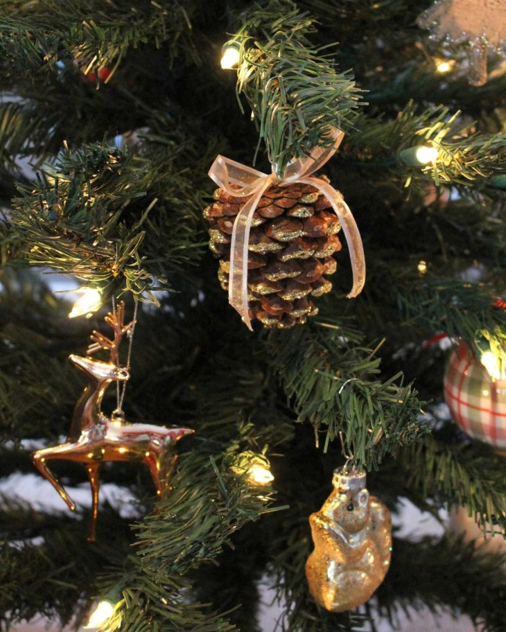 DIY Pinecone Ornaments. Personally, a favorite element to add to the  Christmas tree is something natural. Especially when you choose a fake tree  over a real ...