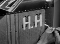 A trunk being re-monogrammed in Foreign Correspondent
