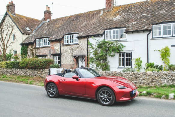 Red Mazda MX 5 in countryside Jurassic Coast Dorset