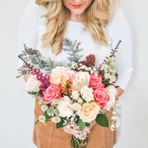Blonde with autumn flowers bouquet