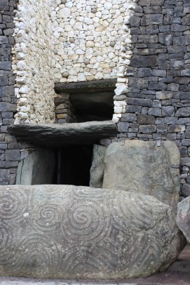 Entrance stone covered in Neolithic carvings.