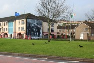 Mural depicting a scene from Bloody Sunday - it's a reproduction of a very famous photograph.