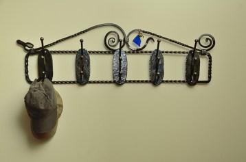 Wrought steel coat rack by Jim Davis