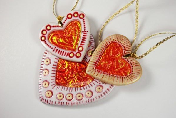 Valentine Hearts made with the Holo Effect Technique created from polymer clay .