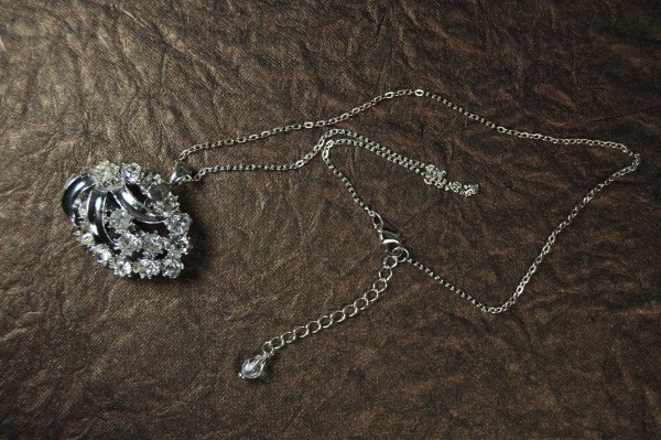 Vintage costume jewelry brooch converted to pendant using a pinch bail.