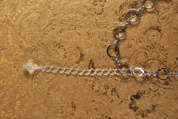Extension chain on necklace, allowing it to be worn at different lengths.
