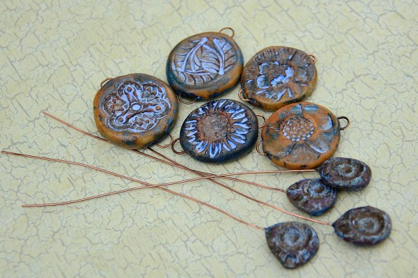 Rustic Connectors in blue tones along with Rustic Headpins, ready to be used in jewelry creations.