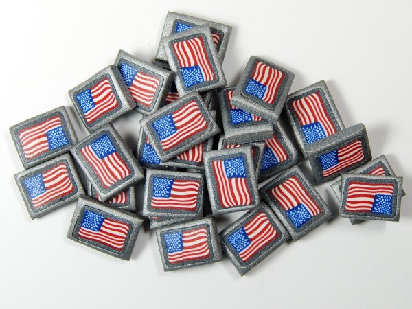 Polymer clay cane slices of the American Flag by The Blue Bottle Tree