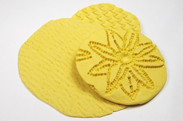 Use RTV Silicone Rubber Mold Putty to make texture sheets for polymer clay.