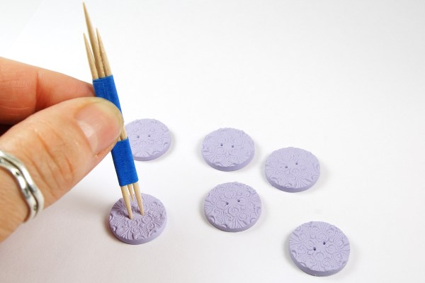 Use three toothpicks taped together to mark where to place buttonholes when you make polymer clay buttons.