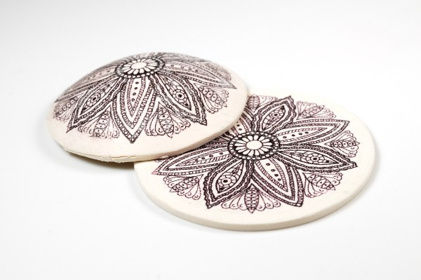 I was able to use laser printed images to create image transfers on Sculpey Souffle polymer clay.