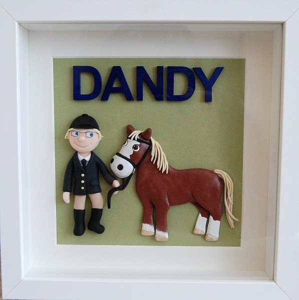Polymer clay portrait of Dandy the pony and his owner Ashlyn. By Echo Crafts.