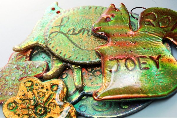 Holo Effect Cutter Ornaments made from regular cookie cutters. Perfect for gift tags and holiday decor.