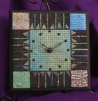 Mosaic clock made with polymer clay.