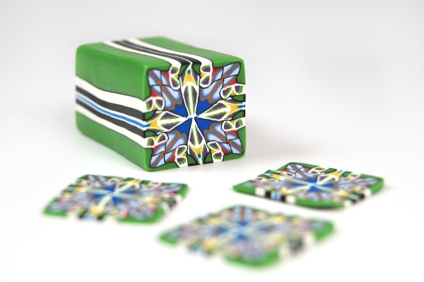 Kaleidoscope cane created with PVClay, a brand of polymer clay from Brazil.