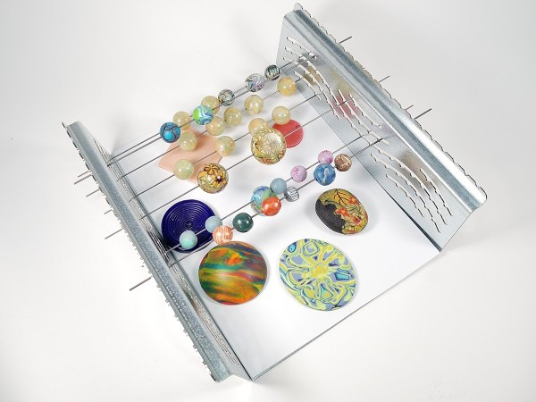 The LC Baker rack from Lucy Clay Tools gives lots of room to bake polymer clay.