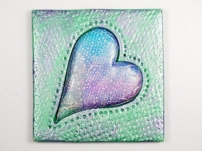 I used the CaBezel heart mold to make the center shape and then textured it with an oven mitt and a toothbrush.