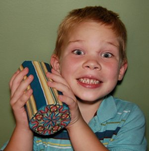 Ivy Niles's son holding one of her huge polymer clay canes.