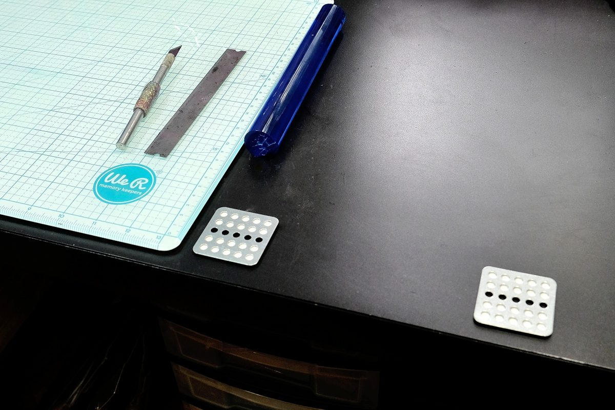 The base for the Czextruder attaches to your workbench with a magnet on these metal pads.