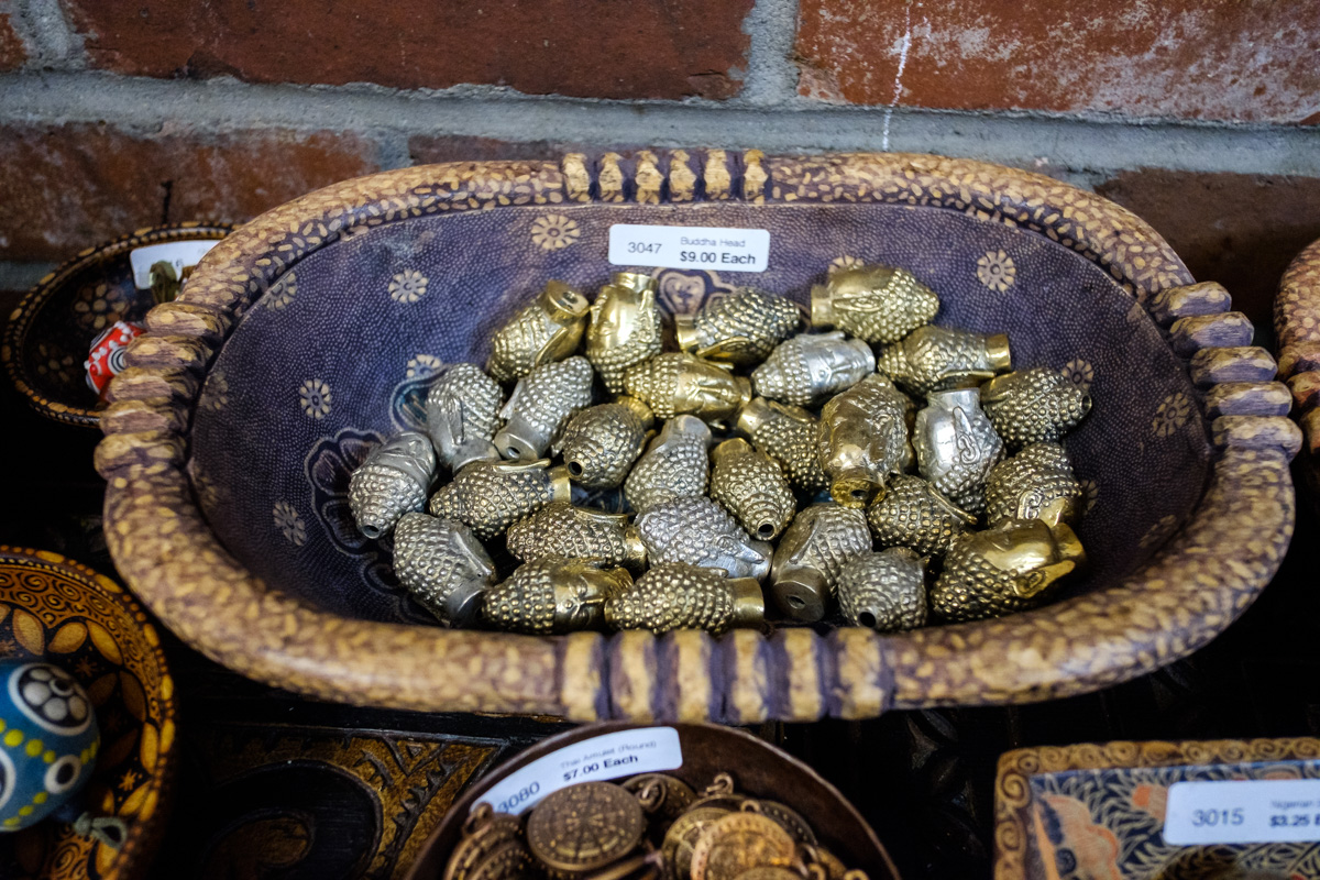 Brass Buddha head beads at Allegory Gallery in Ligonier, Pennsylvania.