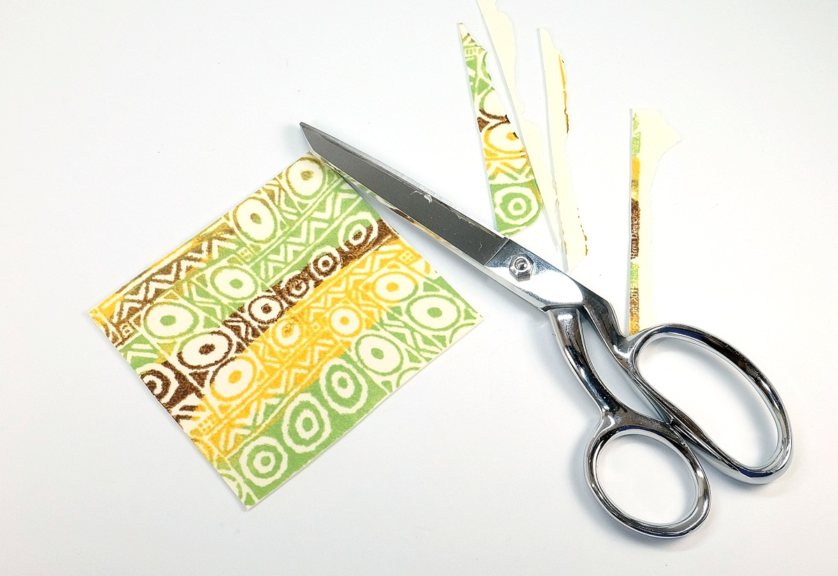 You can cut sheets of Fimo Leather with scissors.