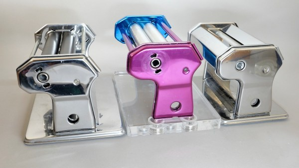 several polymer clay pasta machines showing the mounting slots on the end plates